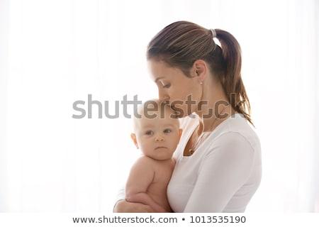 bebek · anneler · silah · kadın · kanepe · gülme - stok fotoğraf © dariazu