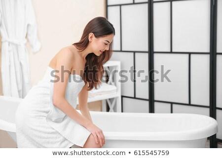 Nő fürdőköpeny ül fürdőkád jókedv portré Stock fotó © IS2