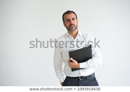 Férfi tart akta néz kamera üzlet Stock fotó © IS2