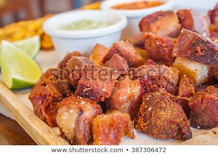 close up of rustic deep fried crispy pork rind Stock photo © milsiart