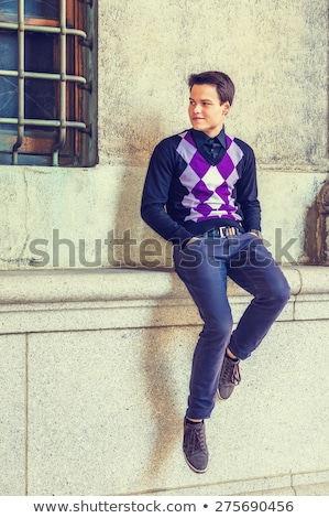 Men sitting on wall outdoors Stock photo © IS2
