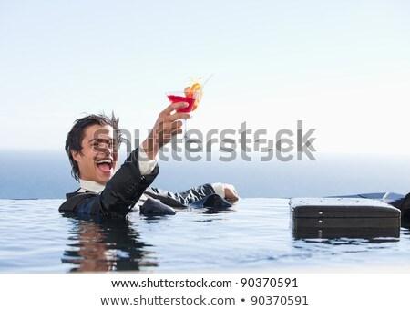 человека · расслабляющая · бассейна · счастливым · портрет · темно - Сток-фото © is2