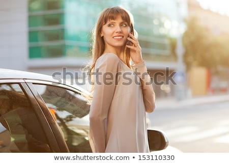 Nő mobiltelefon áll vmi mellett autó boldog Stock fotó © ichiosea