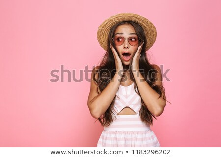 Photo of excited woman 20s wearing sunglasses and straw hat yell Stock photo © deandrobot