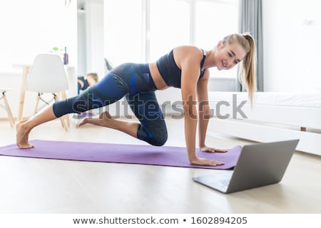 Woman doing exercises for her abs indoors Stock photo © boggy