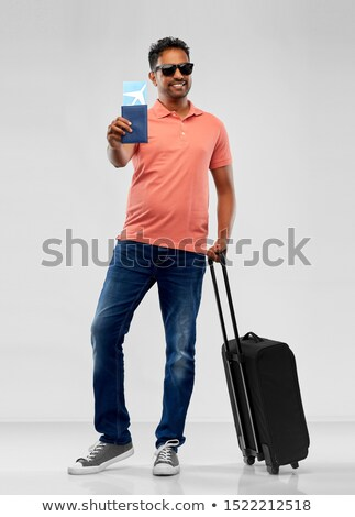 man in sunglasses with travel bag and air ticket Stock photo © dolgachov