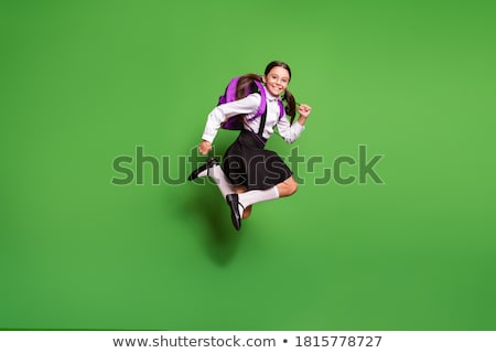 Happy Female Student In Uniform Jumping In Air Stock photo © monkey_business