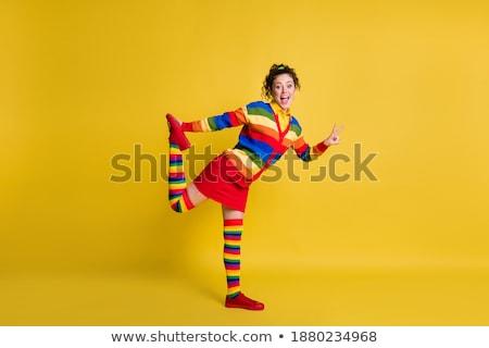 Młoda kobieta pasiasty spódnica buty sukces Zdjęcia stock © dolgachov