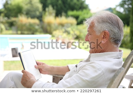 Man reading by the pool stock photo © photography33
