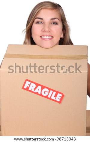 head of blond girl leaning on moving cardboard stock photo © photography33