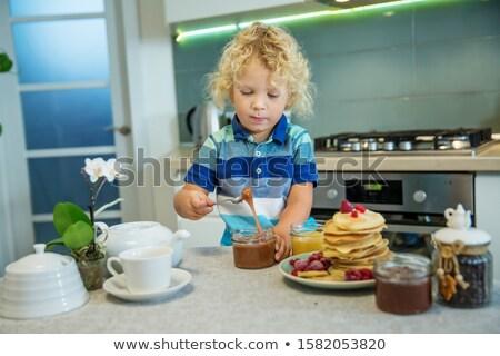Stock photo: Children eating pancakes