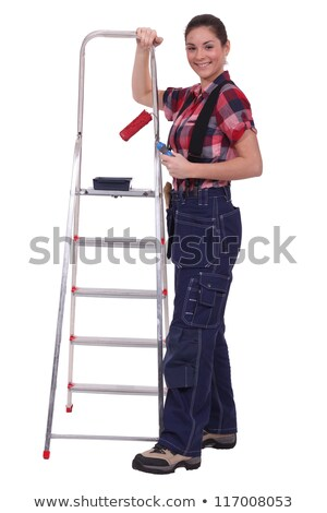 Painter posing with a stepladder and paint roller Stock photo © photography33