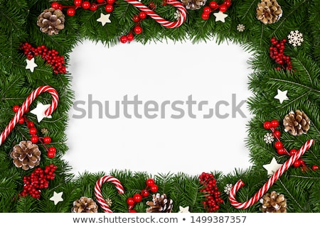 christmas green card with snow around and baubles stock photo © romvo