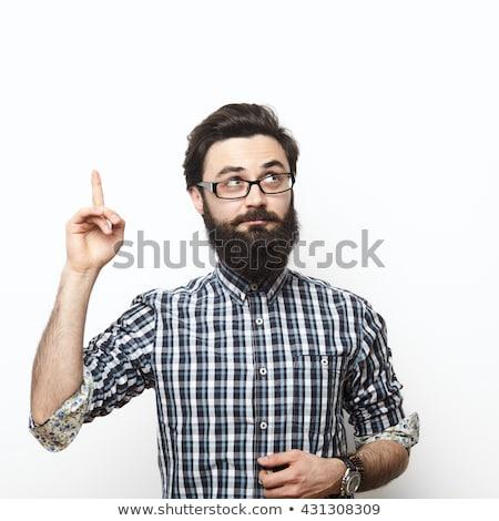 bearded man looks over his glasses stock photo © feedough