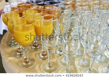 row of glasses with fresh orange juice stock photo © dariazu