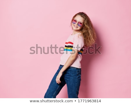 Young woman in long striped dress isolated on white Stock photo © Elnur