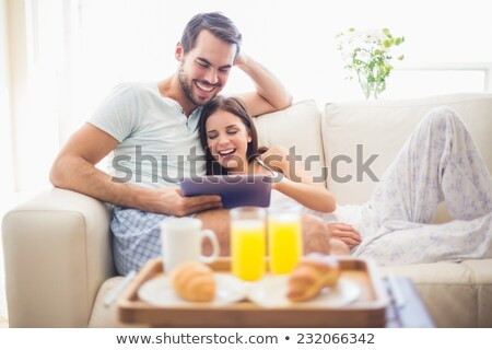 Cute couple relaxing on couch at breakfast Stock photo © wavebreak_media