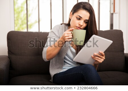 a girl reading while drinking stock photo © bluering