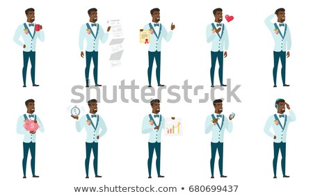 Young african-american groom holding a certificate Stock photo © RAStudio