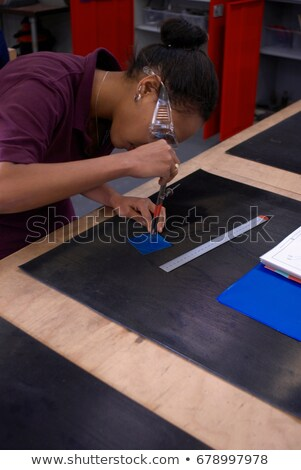 Worker tracing with compass in factory Stock photo © IS2