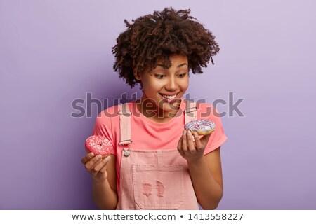 Genç afro kadın yeme tatlı çörek amerikan Stok fotoğraf © NeonShot