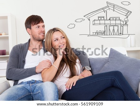 Smiling Couple Thinking Of Getting Their New House Stock photo © AndreyPopov