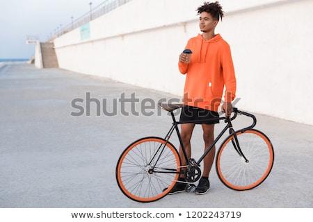 Fiatal afrikai fickó bicikli kint tengerpart Stock fotó © deandrobot