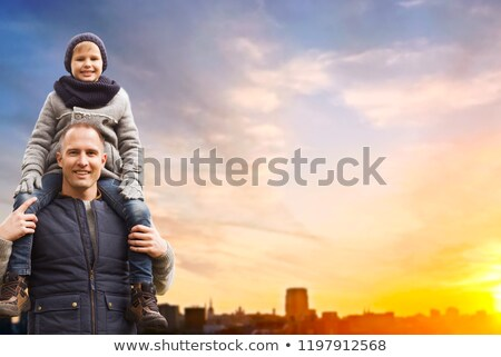 happy father and son over sunset in tallinn city stock photo © dolgachov