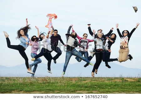 Group of excited young friends having fun time together Stock photo © deandrobot