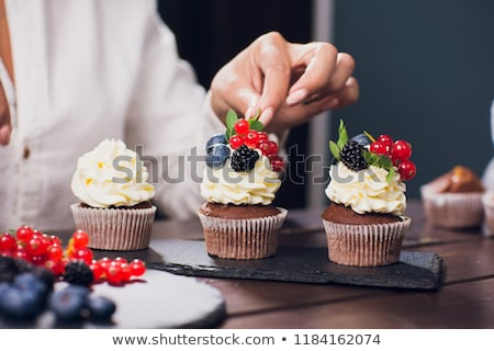 Cupcakes with cream and berries stock photo © furmanphoto