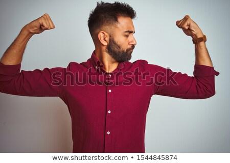 Indian man tonen biceps grijs macht Stockfoto © dolgachov