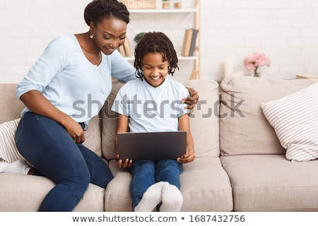 happy children reading and working on computer stock photo © bluering
