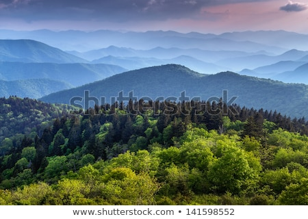 Kék hegyek naplementék völgyek égbolt naplemente Stock fotó © lovleah