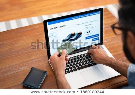 Homem compras on-line cara compras sacos bens Foto stock © jossdiim