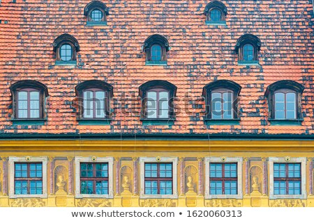 Tiled house roof with window in Wroclaw, Poland Stock photo © kyolshin