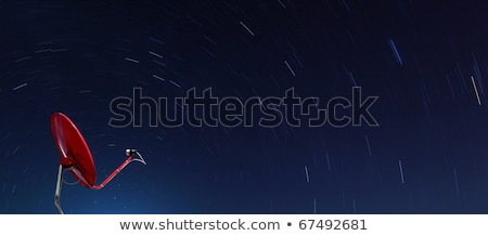 Conceptual Of Red Satellite Over Spiral Star At Night Stok fotoğraf © vichie81