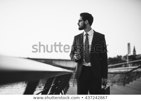 glimlachend · zakenman · praten · telefoon · buitenshuis · vergadering - stockfoto © photography33