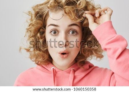 Surprised woman taking off her glasses Stock photo © photography33