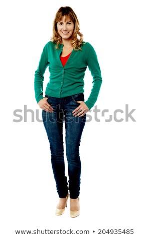 Modern corporate woman striking a stylish pose Stock photo © stockyimages