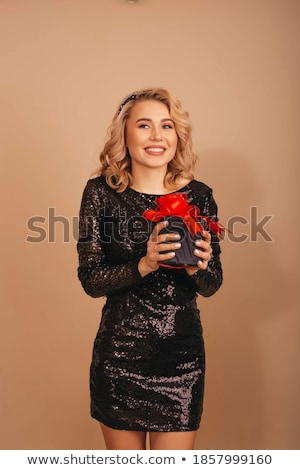 Beautiful woman in red dress isolated on black background. Studi Stock photo © Victoria_Andreas