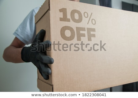 Man holding cardboard paper with sales discount price Stock photo © stevanovicigor