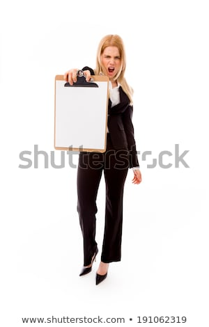 Frustrated businesswoman showing a blank clipboard Stock photo © bmonteny