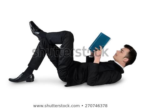 business man reading book down stock photo © fuzzbones0