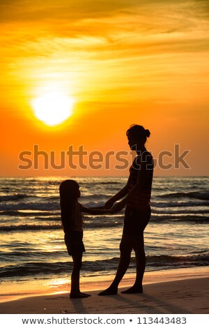 Mother with children ashore on sunset Stock photo © Paha_L