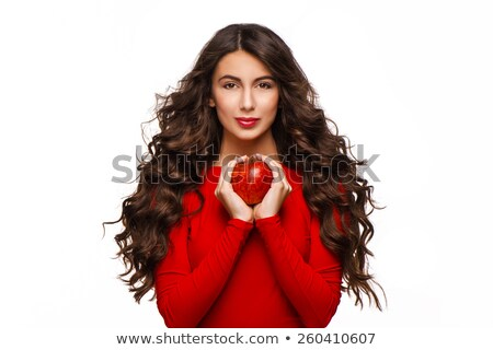 Lovely woman holding apple and looking at camera stock photo © deandrobot