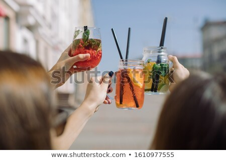 The hands with alcohol cocktails making toast on a bar background Stock photo © master1305