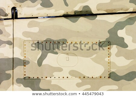 Piece of aircraft grunge metal background, army camo Stock photo © michaklootwijk