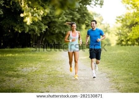 Athlétique femmes hommes courir suivre Photo stock © wavebreak_media