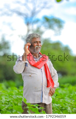 farmer talking on a mobile phone stock photo © rastudio