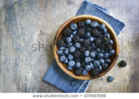Stock photo: Fresh Blueberries in a bowl on dark background, top view. Juicy wild forest berries, bilberries. Hea